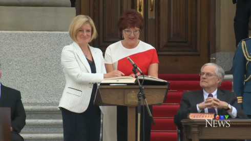 Rachel Notley being sworn into office.