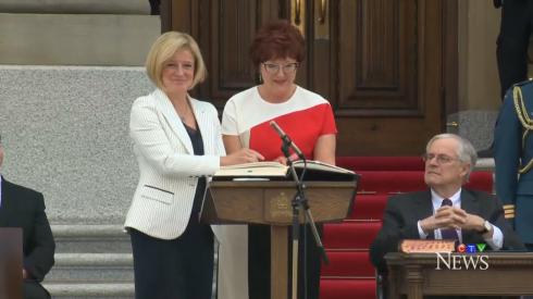 Rachel Notley being sworn into office.