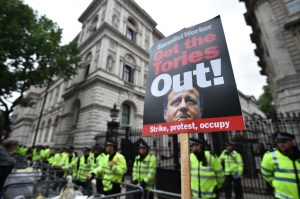 An anti-government protest placard is seen outside Downing Street during a march to protest against the British government's spending cuts and austerity measures in London on June 20, 2015. The national demonstration against austerity was organised by People's Assembly against government spending cuts.   AFP PHOTO / BEN STANSALL